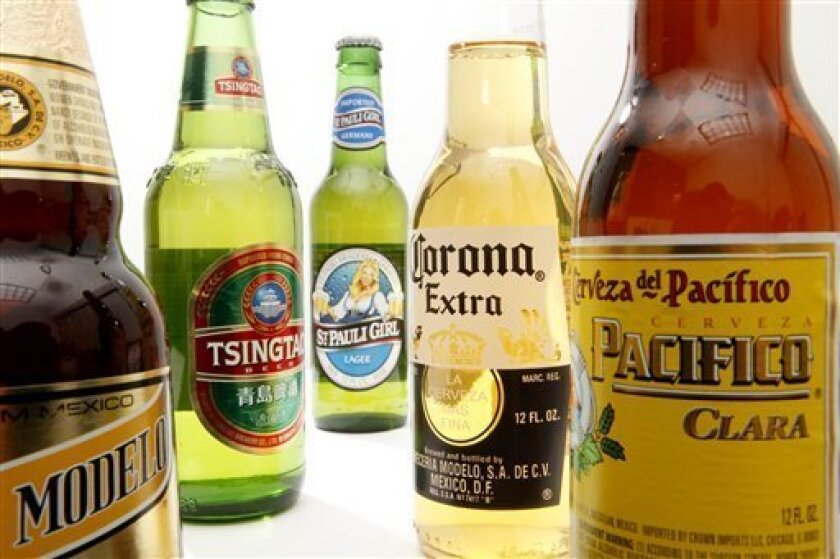 Displayed are bottles of Constellation Brands, Inc., beer products including, Negra Modelo, left, Tsingtao, St. Pauli Girl, Corona Extra and Pacifico in Philadelphia, Tuesday, Oct. 5, 2010. The maker of Robert Mondavi wine and Svedka vodka said Wednesday, Oct. 6, its second-quarter net income fell 8 percent on lower wine, beer and spirits sales. (AP Photo/Matt Rourke)