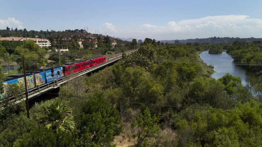A trolley passes over the the San Diego River in Mission Valley on Sept. 6th, 2019.