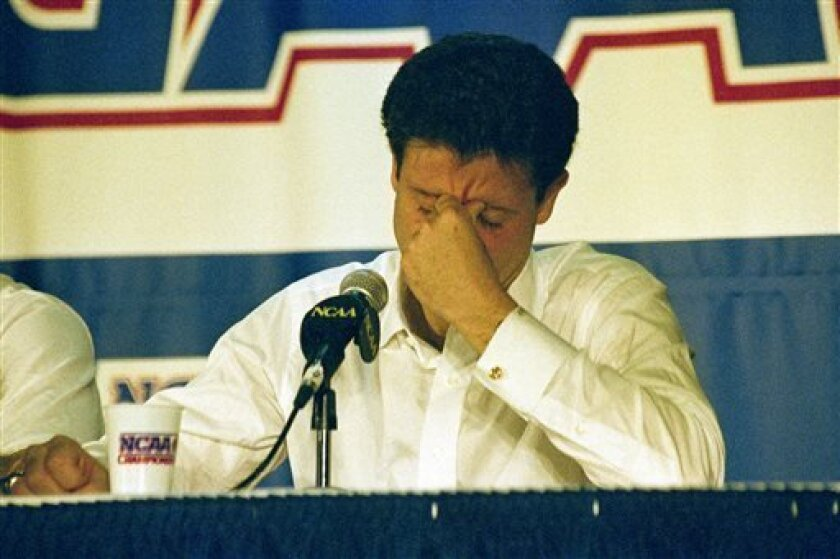 FILE - In this March 28, 1992, file photo, Kentucky head coach Rick Pitino reacts during the end of the East Regional Final NCAA college basketball game news conference following their 104-103 overtime loss to Duke in Philadelphia. For the first time since Christian Laettner's improbable buzzer-bea