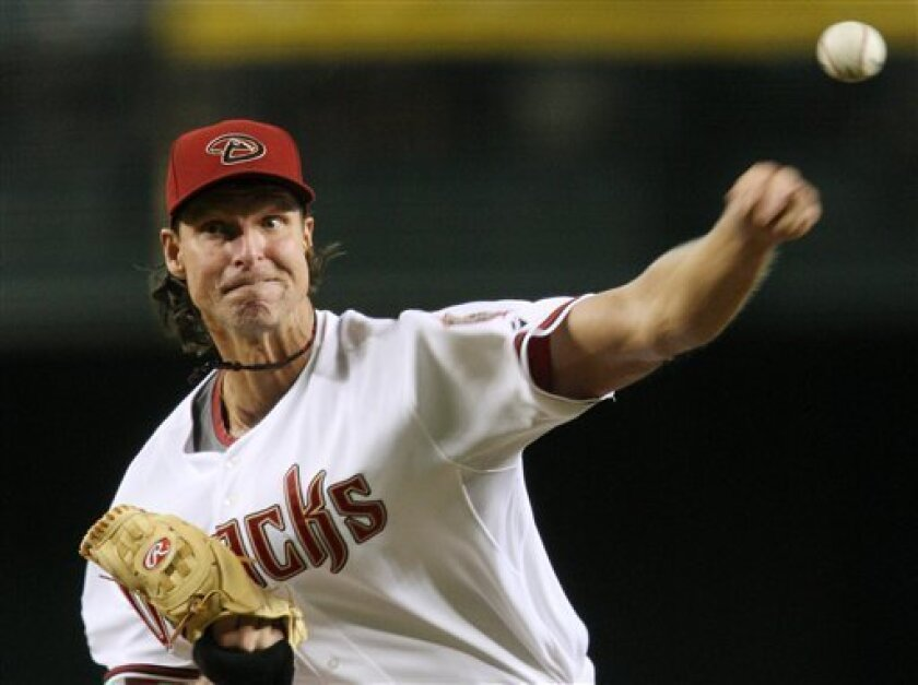 Arizona Diamondbacks' Randy Johnson throws against the Chicago Cubs in the first inning of a baseball game Monday, July 21, 2008, in Phoenix. (AP Photo/Ross D. Franklin)