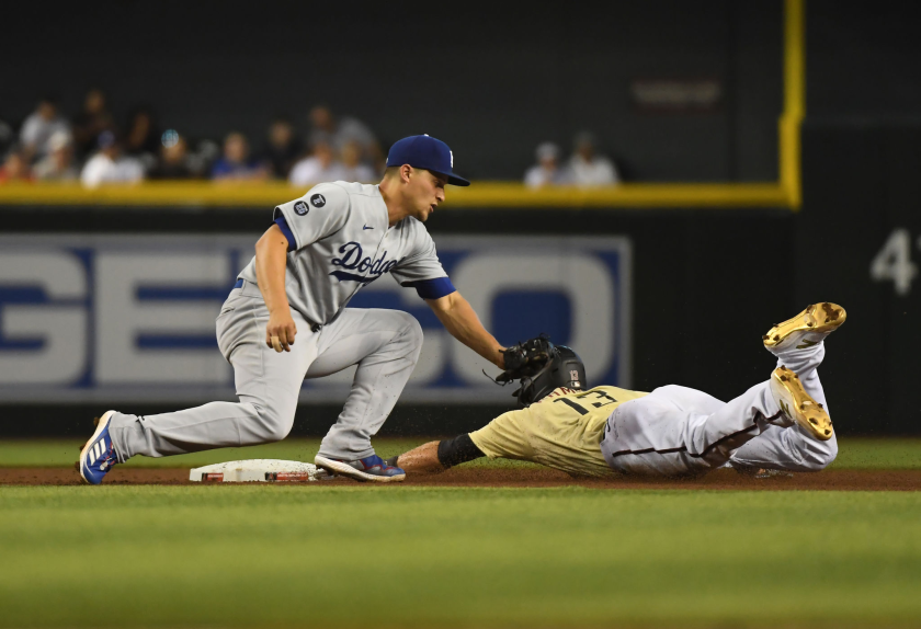 The Diamondbacks' Nick Ahmed steals second base ahead of Dodgers shortstop Corey Seager's tag in the fourth inning.