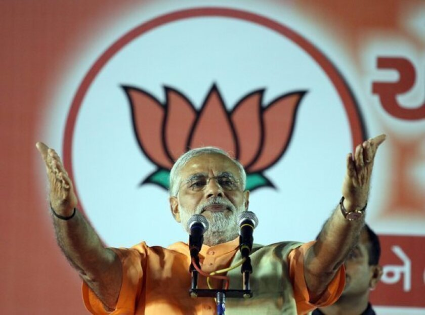 Chief Minister Narendra Modi speaks to supporters in Ahmedabad, India, during a celebration Thursday of the Bharatiya Janta Party's victory in the Gujarat assembly election.