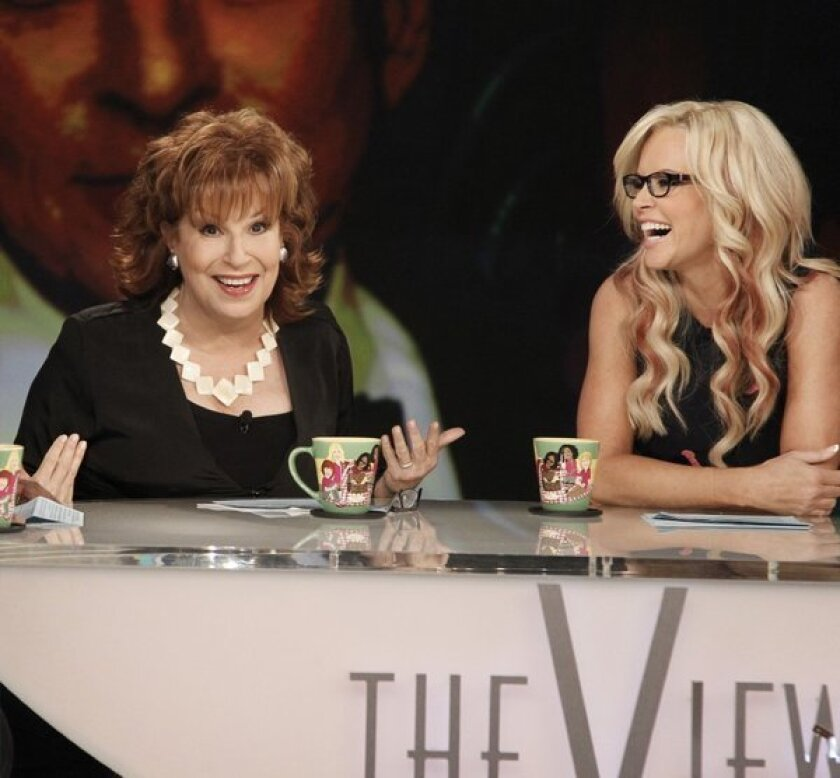 """Jenny McCarthy, seen earlier this year with then co-host of """"The View"""" Joy Behar, makes her debut as a permanent co-host of the morning show on Monday."""