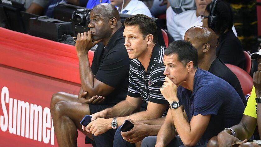 LAS VEGAS, NEVADA JULY 7, 2017-From left, Lakers Magic Johnson, Luke Walton and Rob Pelinka sit cour