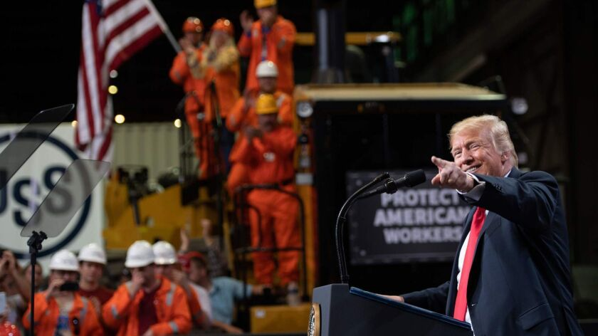 President Trump speaks about trade at U.S. Steel's Granite City Works in Granite City, Ill., in July. U.S. Steel has ramped up production, and the company announced this summer that, thanks in part to the tariffs, its profit will surge.