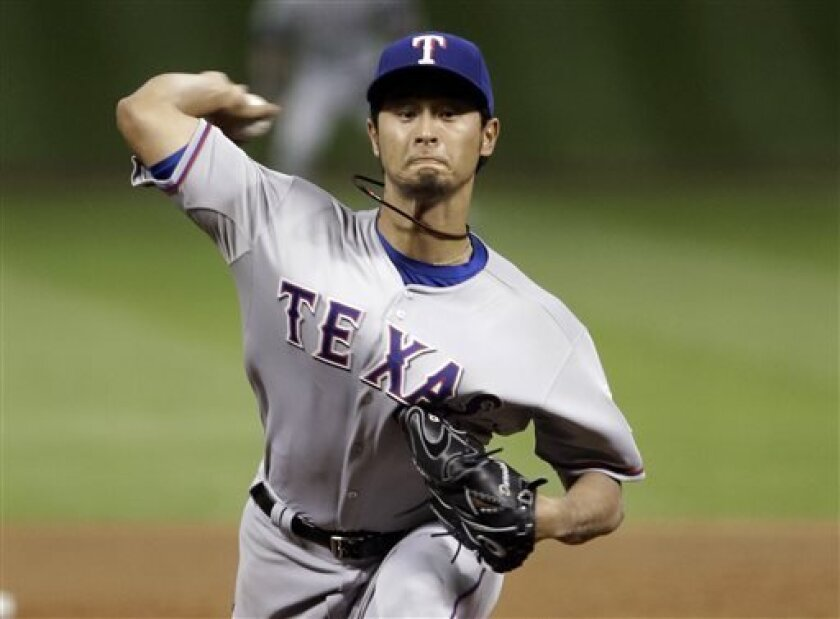 10d5a1a26 Texas Rangers  Yu Darvish delivers a pitch against the Houston Astros in  the fifth inning