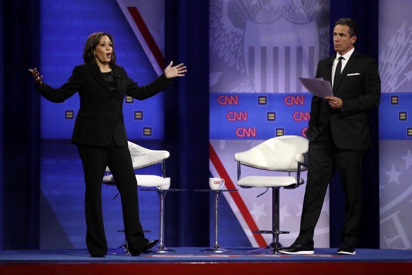 Democratic presidential candidate Sen. Kamala Harris, D-Calif., answers a question as CNN moderator Chris Cuomo listens during the Power of our Pride Town Hall Thursday, Oct. 10, 2019, in Los Angeles. The LGBTQ-focused town hall featured nine 2020 Democratic presidential candidates. (AP Photo/Marcio Jose Sanchez)