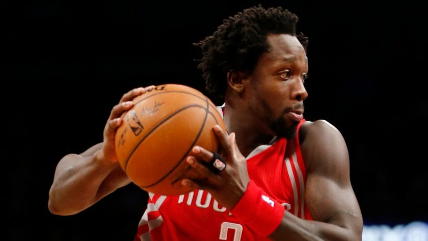 Patrick Beverley looks for room to drive in a game on Dec. 8, 2015.
