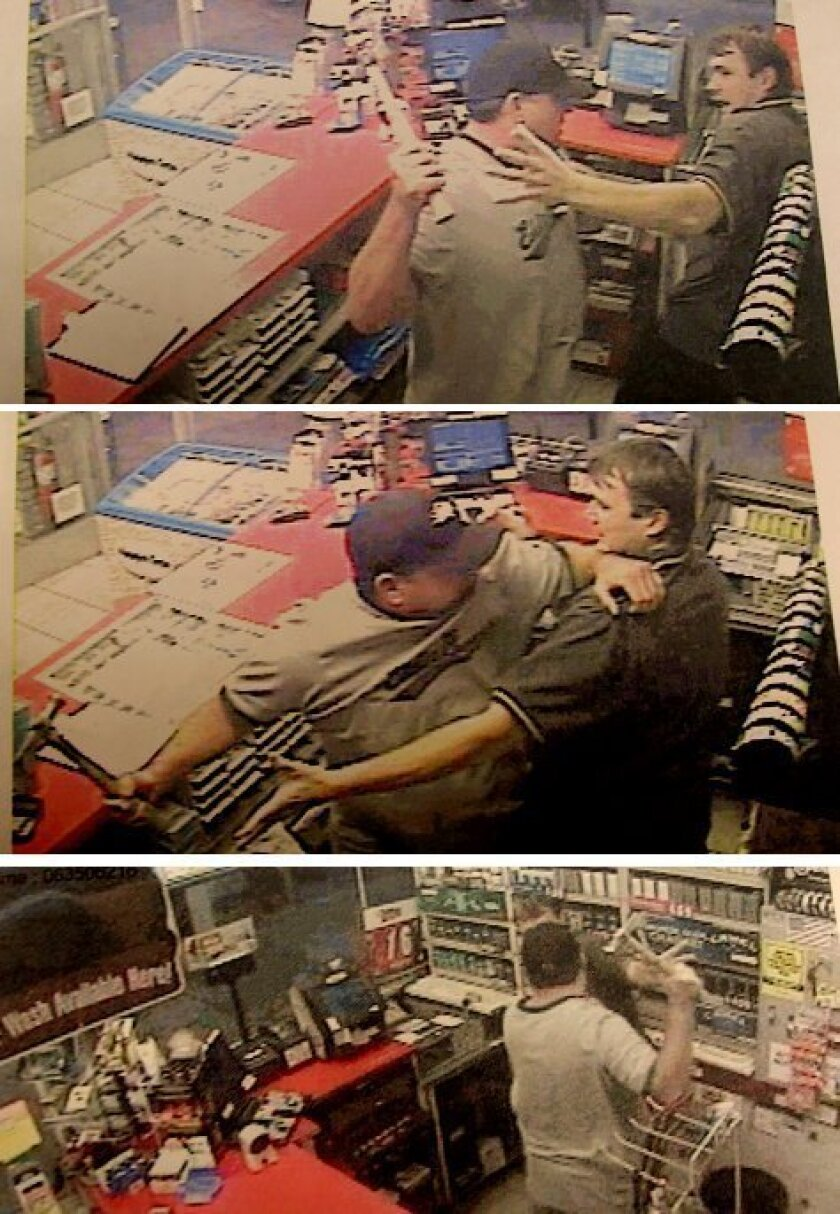 In surveillance film, the suspect is seen threatening a gas station clerk with a hammer.