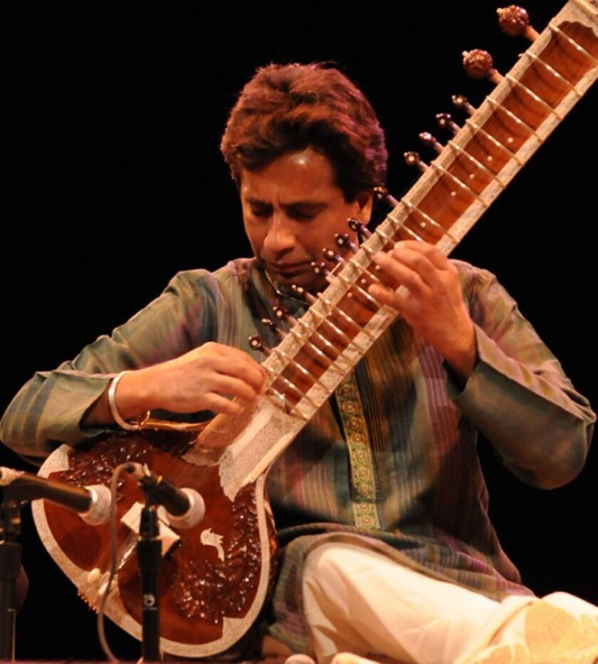 Kartik Seshadri plays the sitar that was damaged last fall in this undated publicity photo.