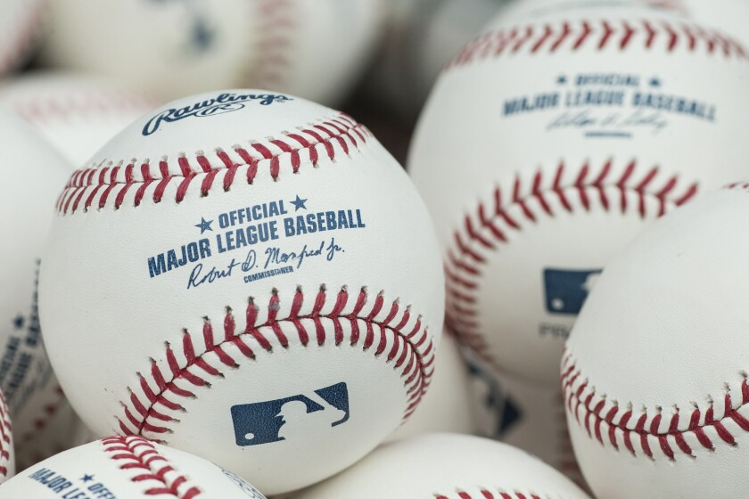 FILE - In this June 6, 2015, file photo, a pile of batting practice balls is viewed during warmups prior to a baseball game between the San Francisco Giants and the Philadelphia Phillies in Philadelphia. Major League Baseball is experimenting with pre-tacked baseballs at some Triple-A games during the last stretch of the minor league season. The test run could be a step toward updating the big league balls after the league cracked down midseason on the use of illegal sticky substances used by pitchers to improve grip. (AP Photo/Chris Szagola, File)