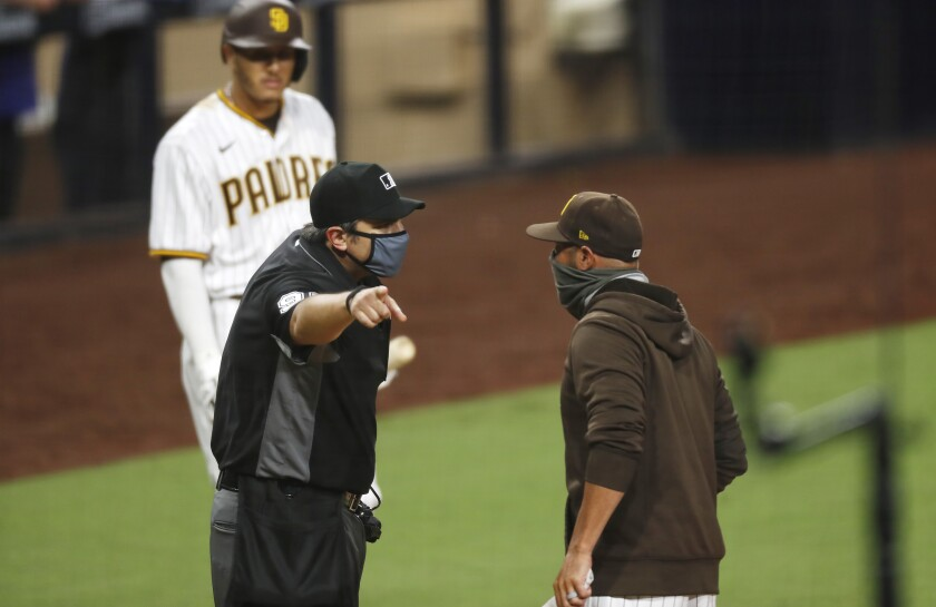 Padres manager Jayce Tingler was ejected by umpire Mark Ripperger after arguing a strike against Manny Machado