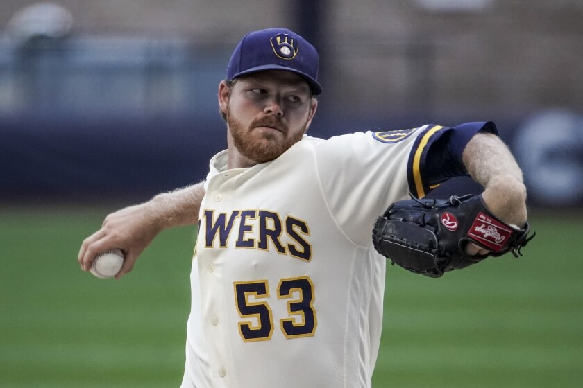Milwaukee Brewers' Brandon Woodruff throws during a practice session Saturday, July 4, 2020, at Miller Park in Milwaukee. (AP Photo/Morry Gash)