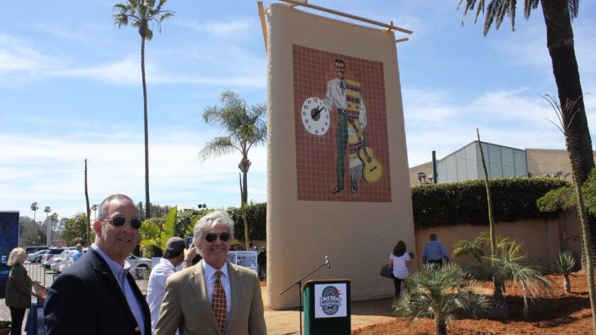 Russ Penniman, left, and Tim Fennell, members of the 22nd District Agricultural Association, which operates the Del Mar Fairgrounds, at Tuesday's unveiling of the relocated Don Diego clock tow