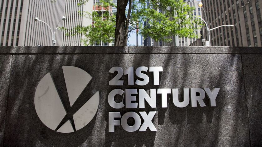 The 21st Century Fox logo is shown outside its New York office, Thursday, June 14, 2018. Competing b