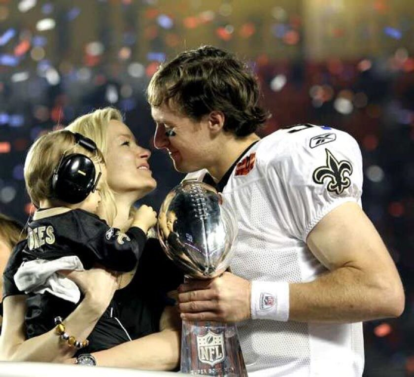 Drew and Brittany Brees celebrate the New Orleans Saints' Super Bowl victory over the Indianapolis Colts on Feb. 7, 2010.