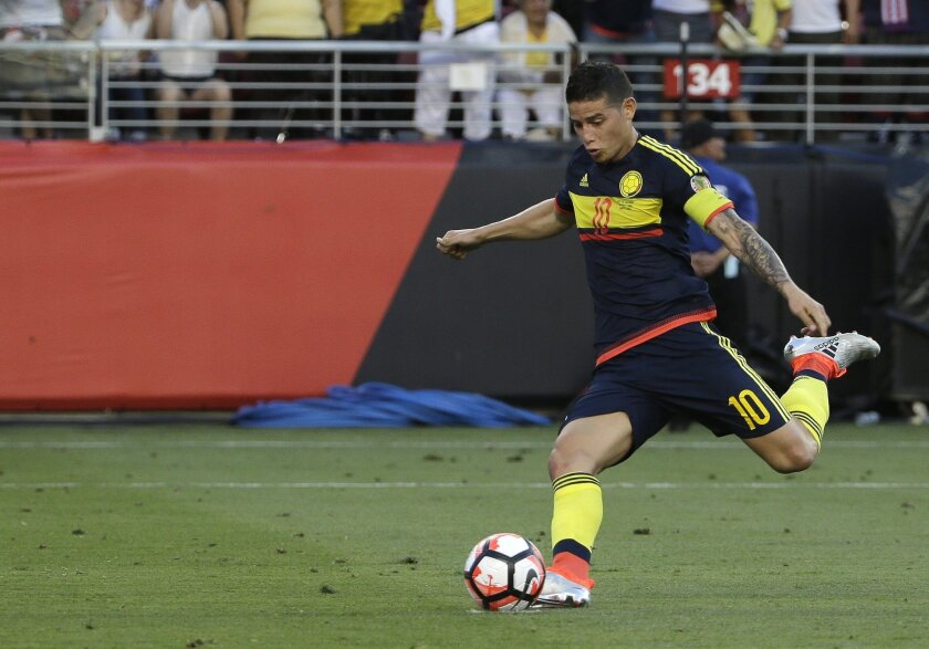 Colombia's James Rodriguez kicks the ball to score a penalty against the U.S. in the Copa America Centenario opening match at Levi's Stadium in Santa Clara, Calif., Friday, June 3, 2016. (AP Photo/Jeff Chiu)
