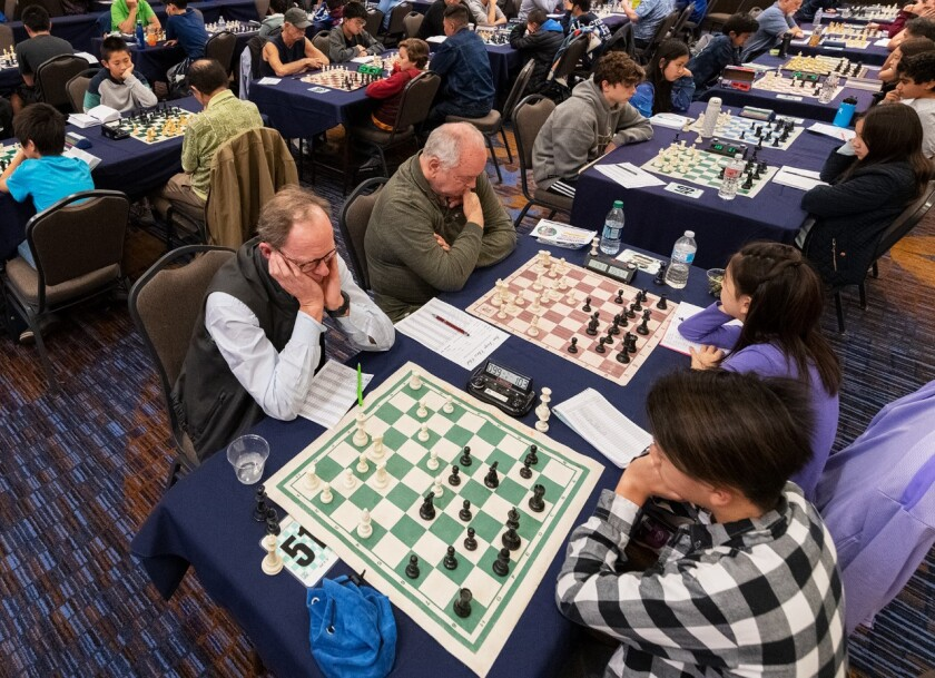 Young and old play at the Dreaming King Open chess tournament in January 2019.