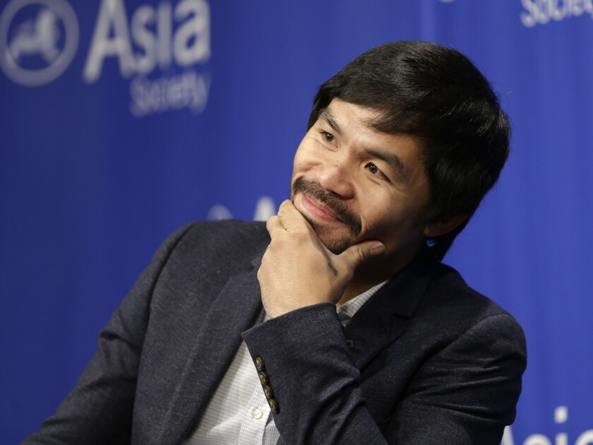 Manny Pacquiao takes questions at the Asia Society in New York on Oct. 12, 2015.