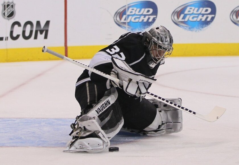 Kings goaltender Jonathan Quick makes a toe save in a 5-1 win over Vancouver at Staples Center on Nov. 9. Quick has been out since suffering a strained groin three days later at Buffalo.