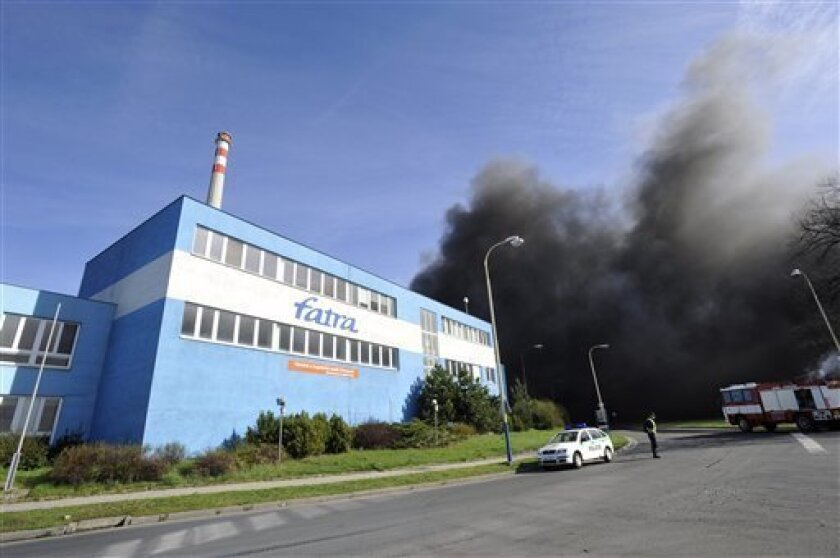 Dark smoke rises after fire broke out in a Czech plastic plant in Chropyne, about 250 km east of Prague, Czech Republic, on Friday, April 8, 2011. An official says more than a hundred of firefighters have been battling a huge fire that hit the factory in the eastern Czech Republic. The cause of the fire is not known yet. (AP Photo/CTK, Zdenek Nemec) SLOVAKIA OUT