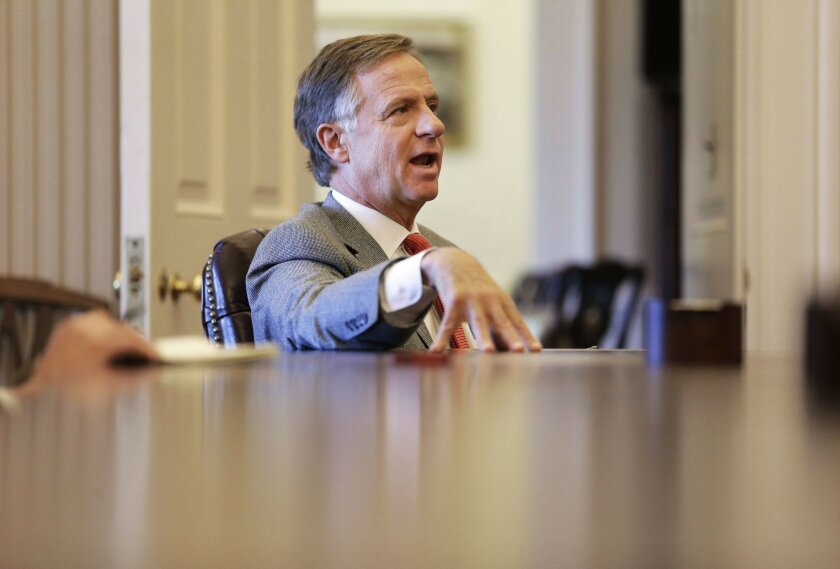 Tennessee Gov. Bill Haslam answers questions during an interview Thursday, Feb. 11, 2016, in Nashville, Tenn. Although the speakers of the Tennessee House and Senate want to allow people with handgun carry permits to be armed at the legislative office complex as soon as possible, Haslam said that h
