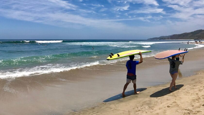 Surfers preparing to paddle out in Sayulita.