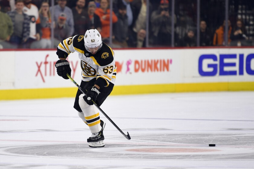 Boston Bruins' Brad Marchand skates by the puck on a shootout attempt in an NHL hockey game against the Philadelphia Flyers, Monday, Jan. 13, 2020, in Philadelphia. The Flyers won 6-5. (AP Photo/Derik Hamilton)