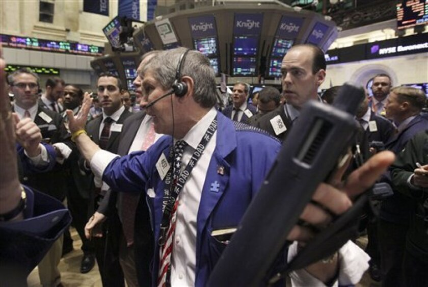 Trader Richard Newman, center, works on the floor of the New York Stock Exchange Friday, April 8, 2011. (AP Photo/Richard Drew)