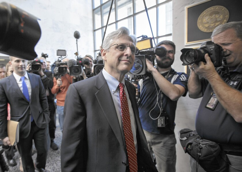 Supreme Court nominee Merrick Garland en route to meet his first Republican senator, Mark Steven Kirk of Illinois, on Capitol Hill.