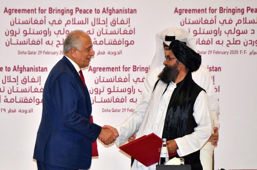 U.S. and Taliban negotiators sign a peace agreement