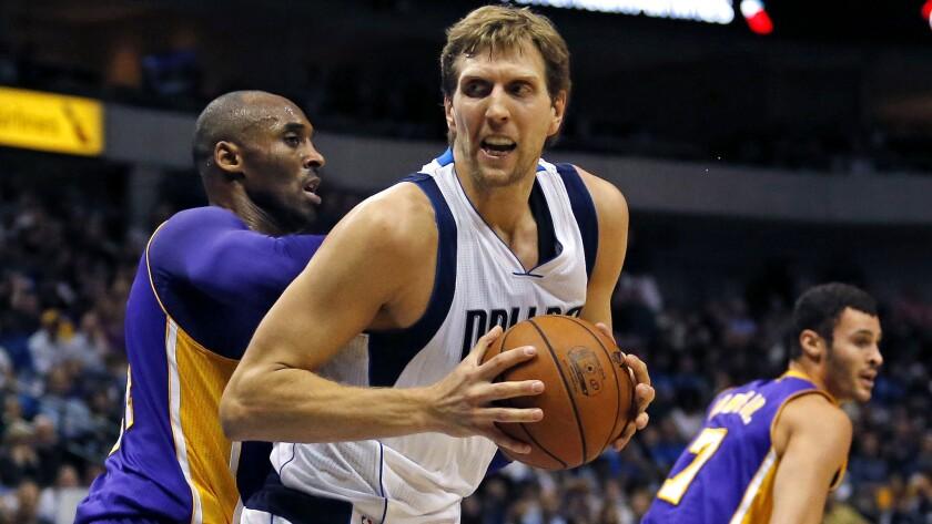 Mavericks forward Dirk Nowitzki works in the post against Lakers guard Kobe Bryant during a Nov. 13 game in Dallas.