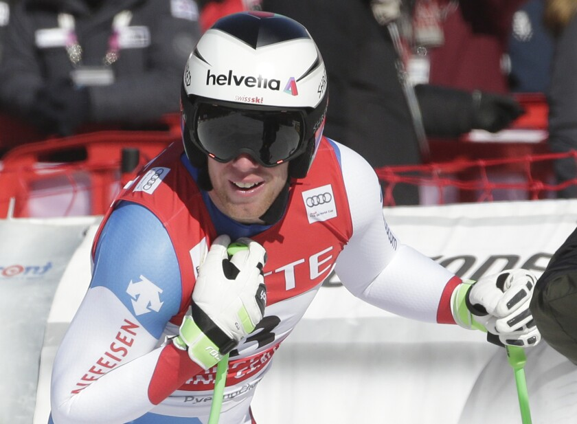FILE - In this Saturday, Feb. 6, 2016 file photo, Switzerland's Marc Gisin reacts after crossing the finish line during a men's World Cup downhill race, also a test event for the Pyeongchang 2018 Winter Olympics, at the Jeongseon Alpine Centre in Jeongseon, South Korea. Swiss downhill racer Marc Gisin announced the end of his career Monday Nov. 30, 2020, saying he had not fully recovered from a serious crash two years ago. Gisin was placed in a medical coma after hitting the snow hard at the Saslong course at Val Gardena, Italy. (AP Photo/Mark Schiefelbein, File)