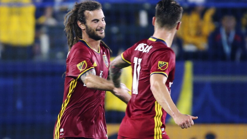 Real Salt Lake midfielder Kyle Beckerman, left, is congratulated by teammate Albert Rusnak after scoring a goal against the Galaxy in the first half Tuesday night.