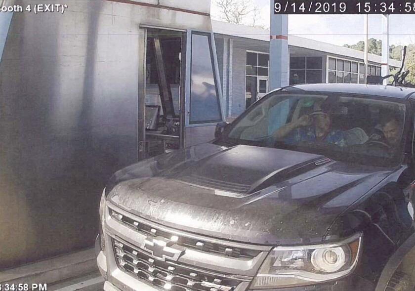 """FILE - This image taken from a Sept. 14, 2019, video and released in a U.S. Attorney detention memorandum, shows Brian Mark Lemley Jr, driving, and Patrik Mathews, passenger seat, passing through a toll booth near Norfolk, Va., en route to Georgia. The pair, along with William Garfield Bilbrough IV, plotted to carry out """"essentially a paramilitary strike"""" at a Virginia gun rights rally, a federal prosecutor said Wednesday, Jan. 22, 2020. FBI agents arrested Mathews, Lemley and Bilbrough on Jan., 16, as part of a broader investigation of The Base, a white supremacist group. (U.S. Attorney via AP)"""