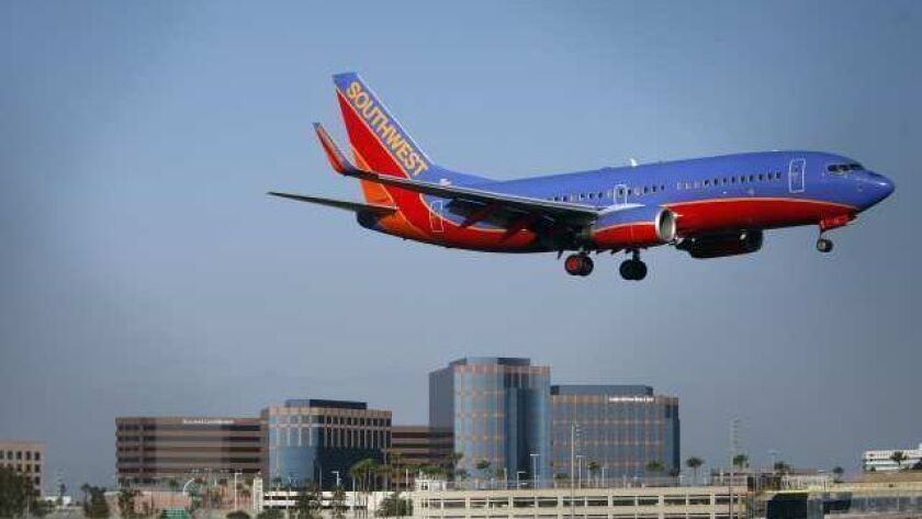 IRVINE, CA - APRIL 12, 2011: A Southwest airplane approaches John Wayne Airport as the Irvine Conco