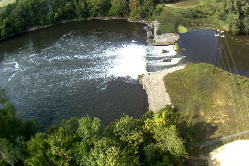 In this Sept 13, 2018 photo provided by the Environmental Protection Agency shows an aerial view of the Trowbridge Dam on the Kalamazoo River near Allegan, Mich., in southwestern Michigan. The aging dam will be taken down under an agreement reached between federal officials and NCR Corp., one of the companies whose paper mills polluted the river with toxic PCBs in the last century. (Paul Ruesch/Environmental Protection Agency via AP)