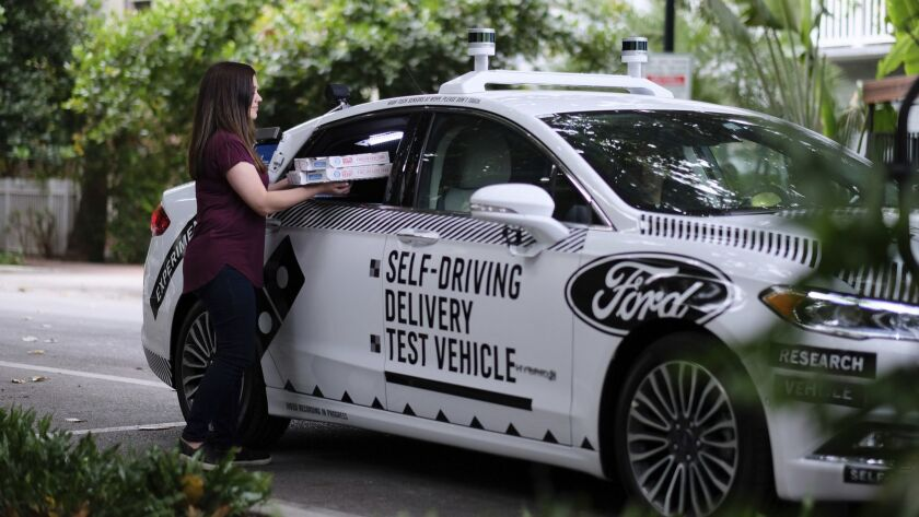 This undated image provided by Ford Motor Company shows a self-driving vehicle from Ford and partner