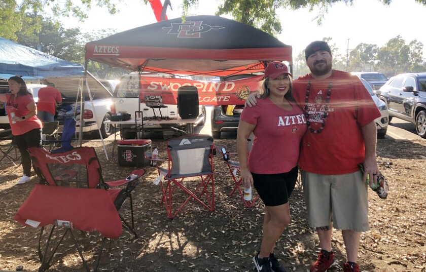 Donney and Deb Cummins of Escondido are tailgate veterans in Carson after coming three previous years for Chargers games.