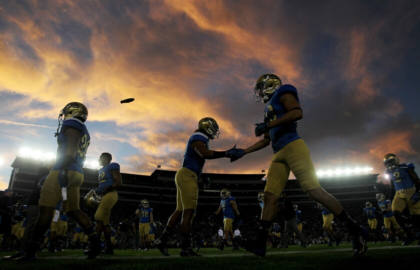UCLA players warm up before the start of a game against USC at the Rose Bowl.
