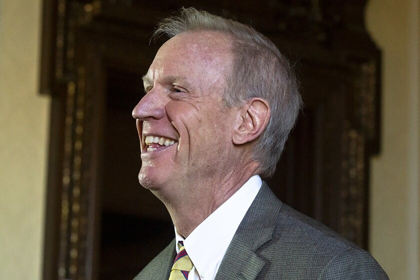 FILE - In this Jan. 8, 2019 file photo, now former, Illinois Gov. Bruce Rauner speaks during a press conference in his office at the Capitol, in Springfield, Ill. Illinois' top leaders trumpeted the benefits of automatic voter registration when signing a 2017 bipartisan effort into law: more civic participation, fewer barriers to the ballot box and modernized systems. But the state hasn't lived up to its promise with a rollout that's behind schedule and several state agencies struggling to get on board. (Rich Saal/The State Journal-Register via AP File)