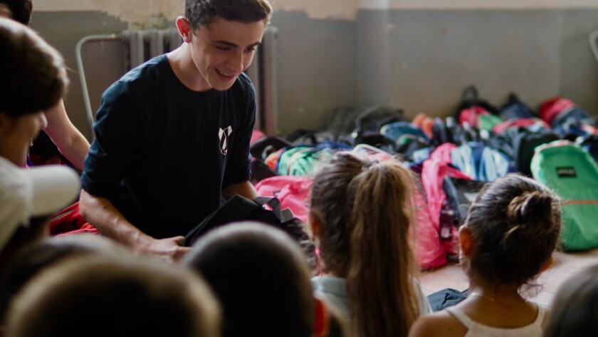 Pacific Ridge junior Alex Balikian recently visited Sarigyugh, Armenia, to deliver backpacks filled with additional school supplies that were purchased by his classmates.
