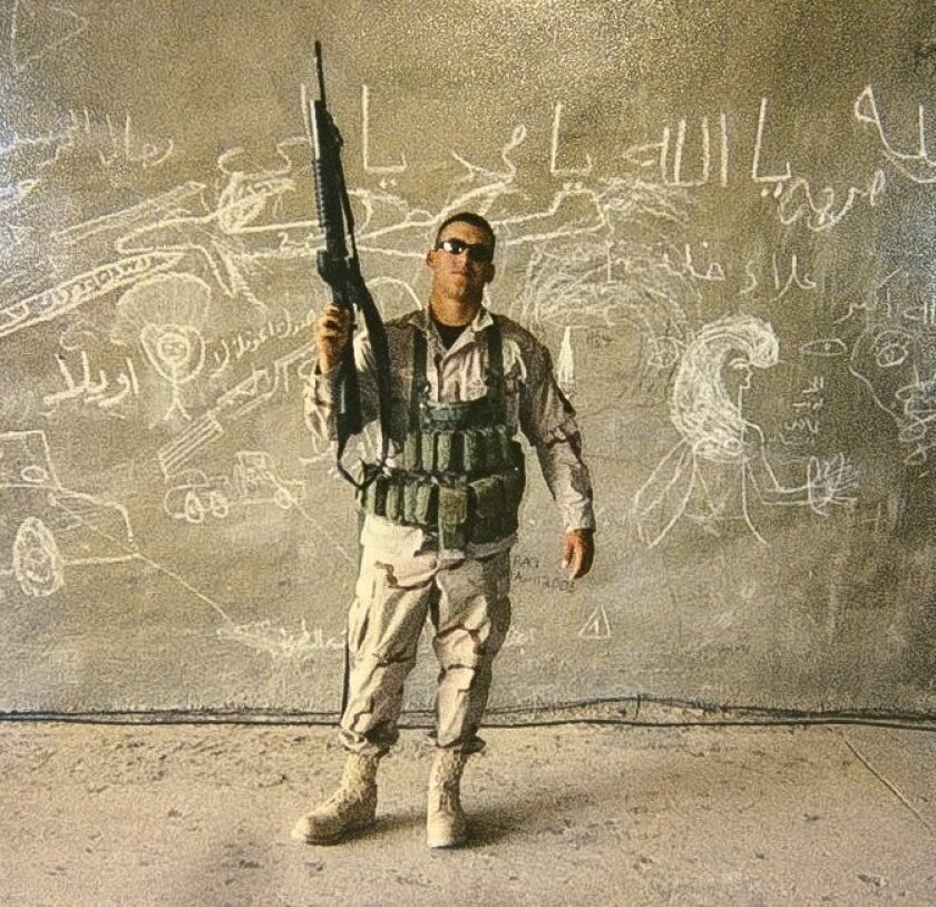 Air Force military policeman Mike Cruz poses for a picture while serving in Iraq in 2004.
