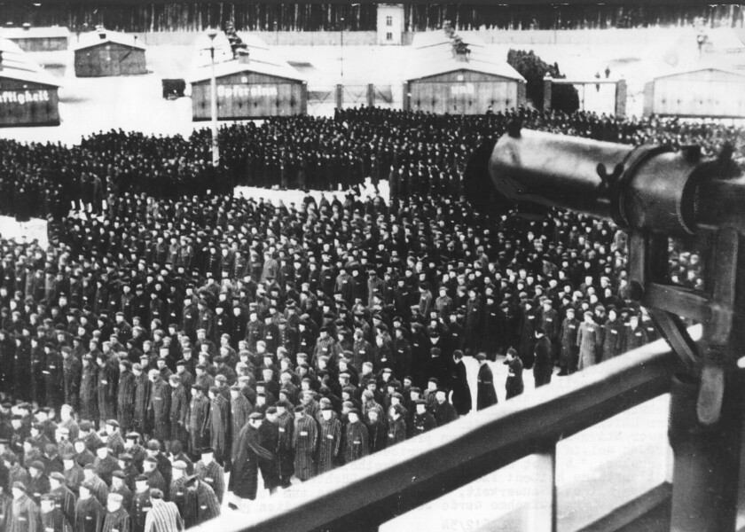 Prisoners massed for roll call in Nazi concentration camp