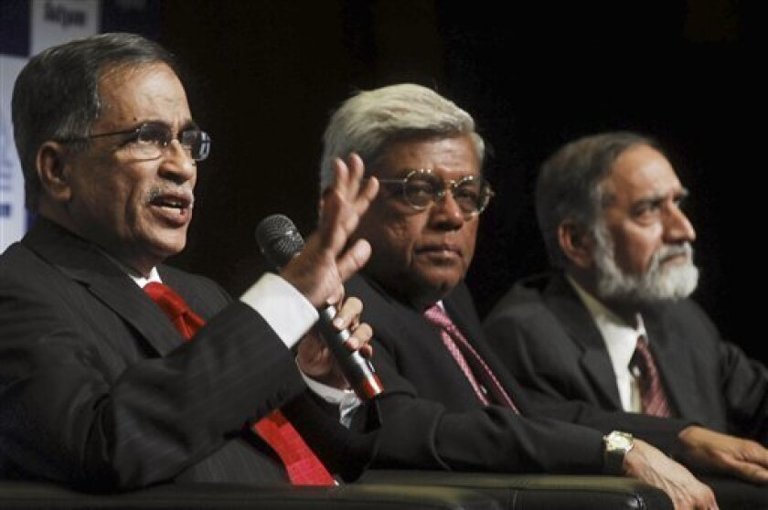 New board members of Satyam Computer Services, from left, a legal expert and Securities and Exchange Board of India's former member C. Achuthan, Housing Development Finance Corp. bank head Deepak Parekh and Nasscom, a trade body of technology companies former head Kiran Karnik address the media in