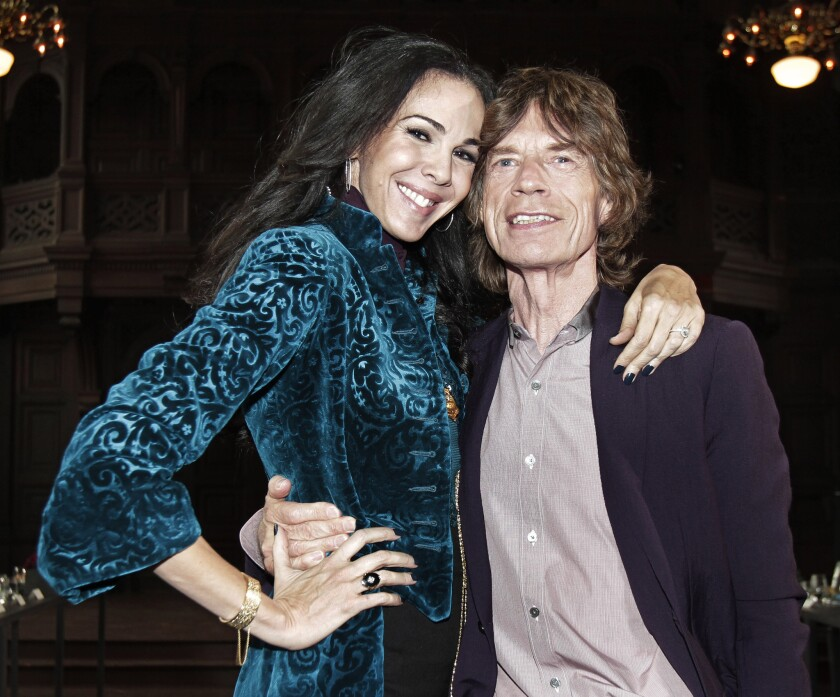 Fashion designer L'Wren Scott, who was found dead in her Manhattan apartment on Monday, with her boyfriend during New York Fashion Week last month.
