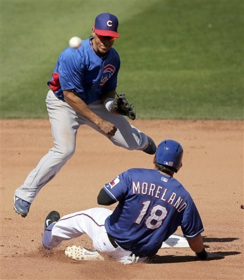 Chicago Cubs second baseman Edwin Maysonet throws to first to complete a double play hit into by Texas Rangers' Craig Gentry, after forcing Mitch Moreland (18) out at second during the fourth inning of an exhibition spring training baseball game Wednesday, March 6, 2013, in Surprise, Ariz. (AP Photo/Charlie Riedel)