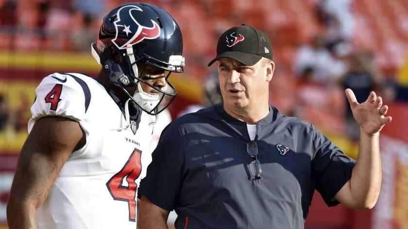 FILE - In this Aug. 9, 2018, file photo, Houston Texans quarterback Deshaun Watson (4) listens to he