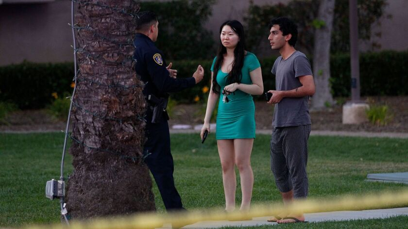 A San Diego Police Department officer stops to question a couple on Sunday, April 30, 2017 near the