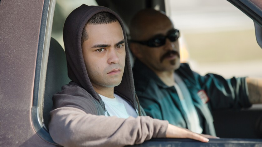 "Gabriel Chavarria, left, and Demian Bichir in the film ""Lowriders."""